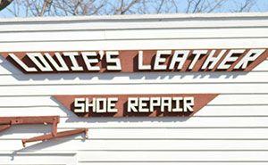 Werbeschild für Schuhreparaturen