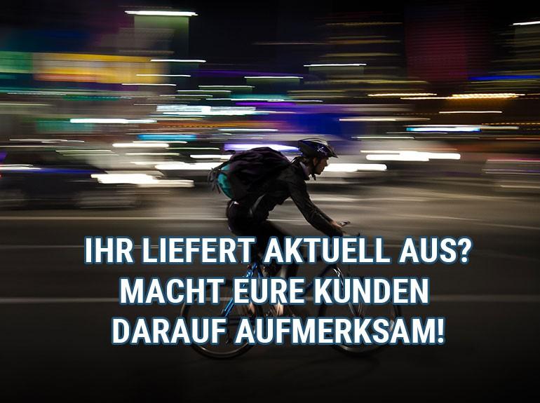 Fahrradfahrer, der ein Lieferservice ist